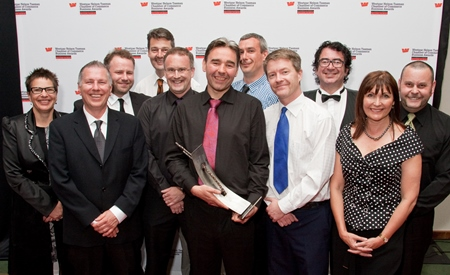 The BlueBerryIT team after receiving their award. Photo by Harold Mason Photography.